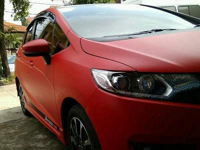 wrapping stiker mobil | jazz full merah doff | mangele stiker 081227722792