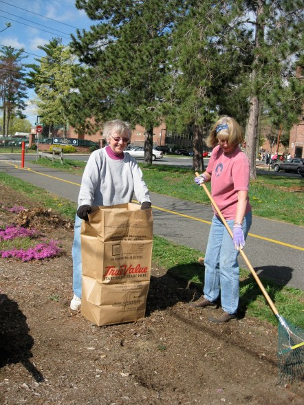 Manhan Rail Trail Committee members Eleanor Kwolek and Barbara LaBombard help clean up the trail near the mural this past spring.