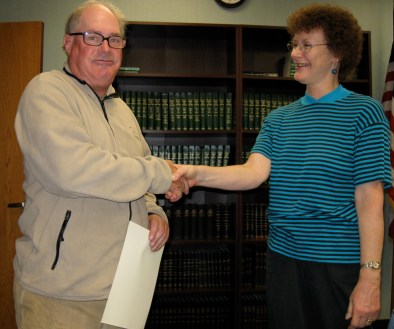 Friends of the Manhan Rail Trail President Liz Sturgen congratulates volunteer Paul Donais at the group's annual meeting in October. Paul was named Friends 2010 Volunteer of the Year for his dedicated service to the trail.