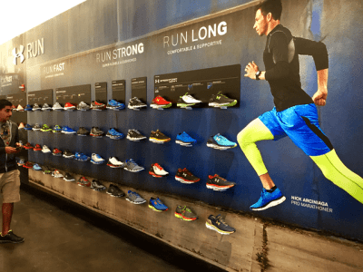 Running shoes displayed with wall vinyl graphic