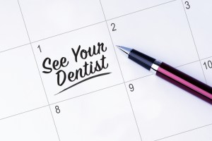 The words See Your Dentist written on a calendar planner