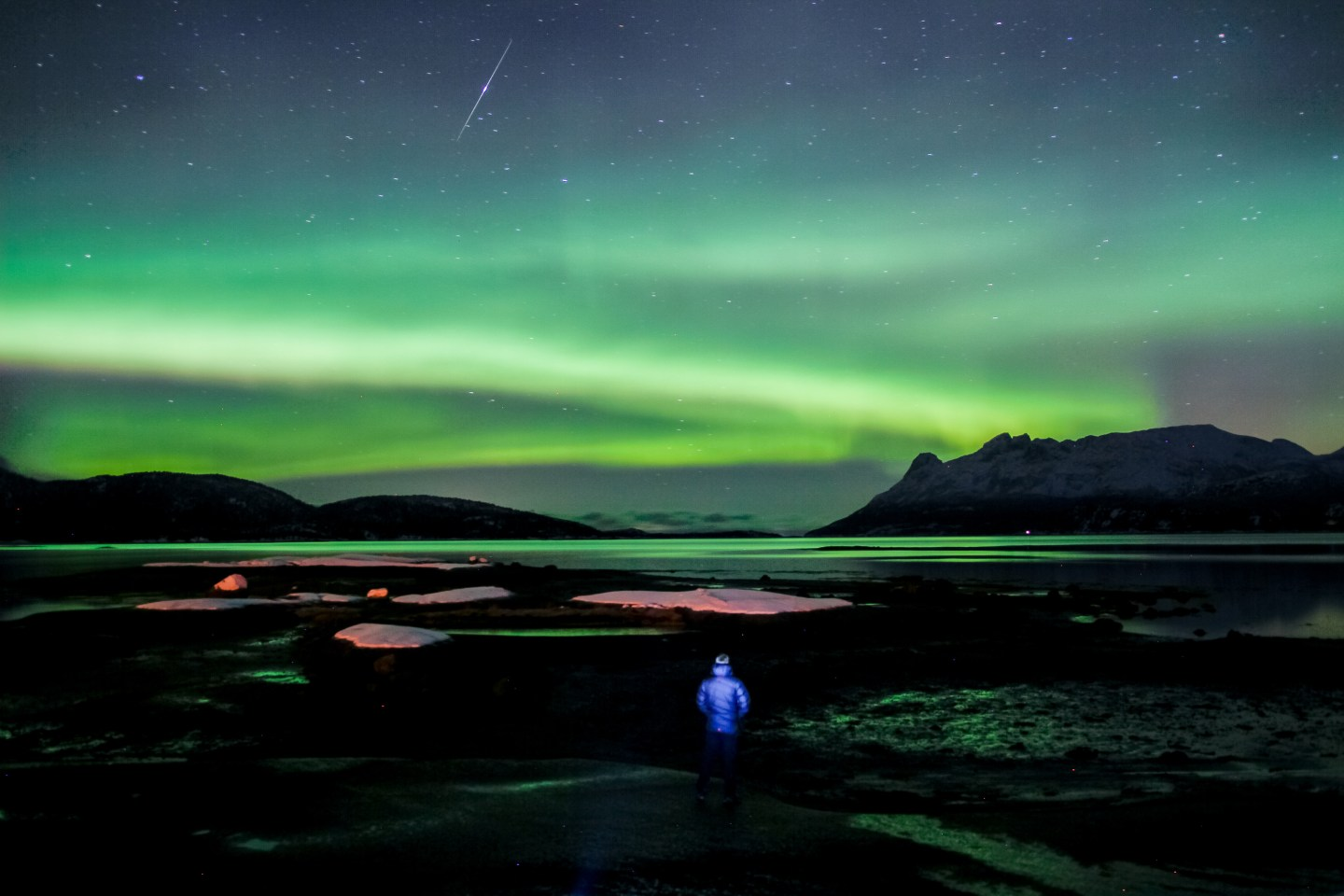 Man watching the northern lights in Hamarøy, Norway