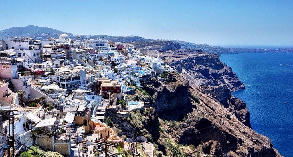 Don't be fooled! Santorini isn't just for honeymooners. Here's how to have fun on a girl's trip to the famous Greek island.