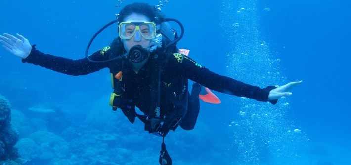 Even first timers can scuba dive in the Great Barrier Reef with the help of a guide.