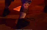 ace of spades tattoo on the calf of a musician onstage