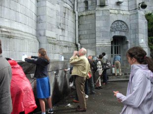 taps of Lourdes water from sacred spring