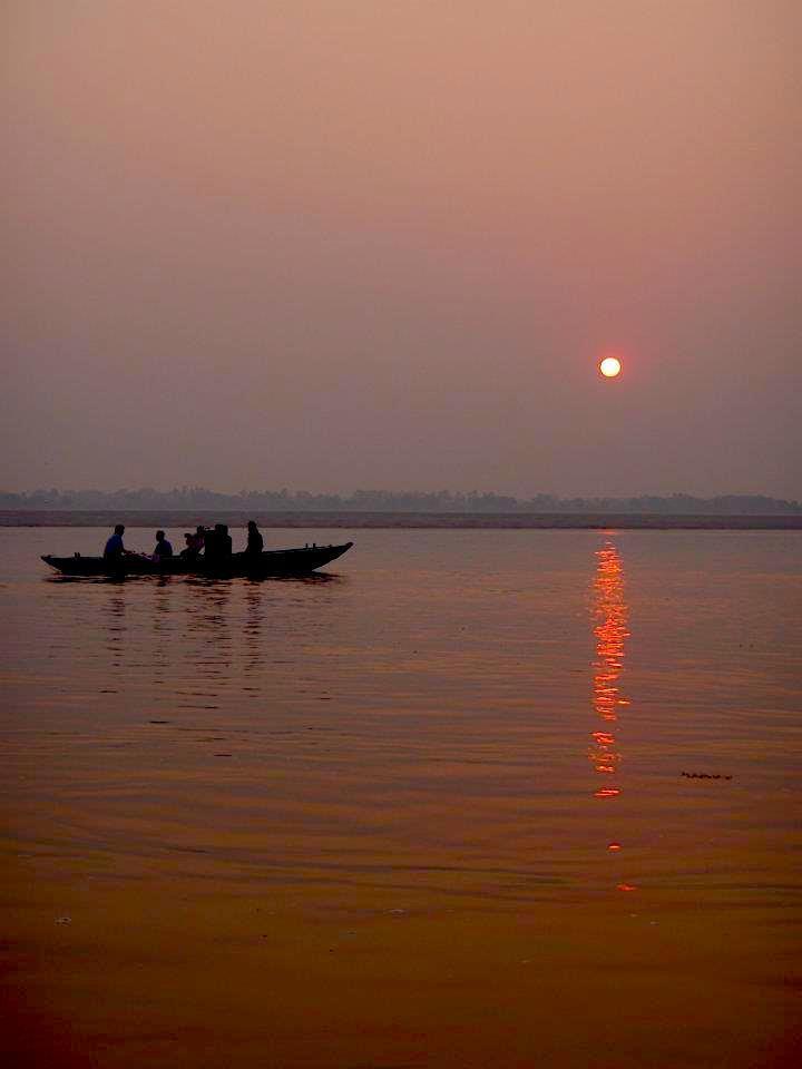 Varanasi -Between life & death - Sunset in the river. maninio.com