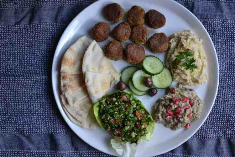 Middle Eastern plate - Greek Lagana bread with Star anise (Clean Monday) | Vegan. maninio.com