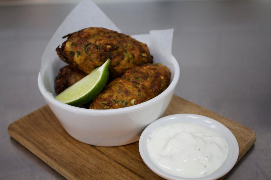 Courgette and manouri fritters, cardamom yoghurt at NOPI