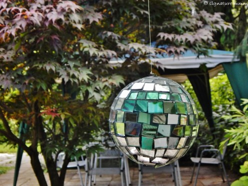 Mother discovered these small disco balls somewhere and now we all have one. This one is in my uncle's garden in Ljubljana.
