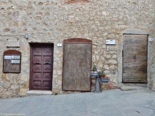 Exploring doors of Capalbio.