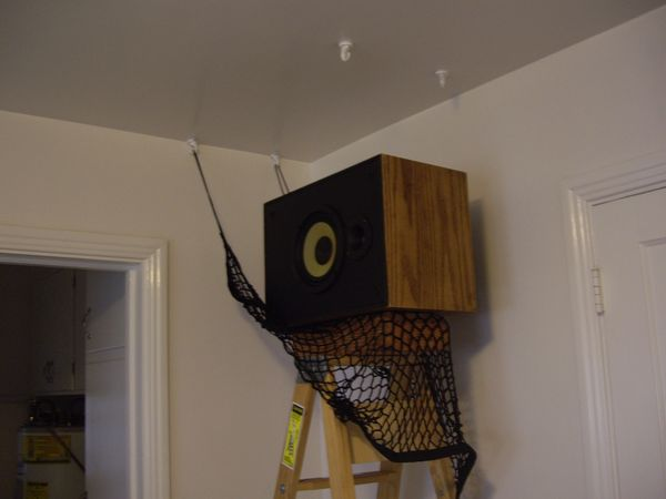 How to Hang Speakers on the Ceiling Using Cargo Net