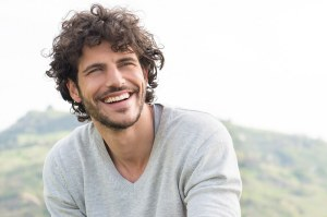 Young man with white teeth. Anti-aging regimen