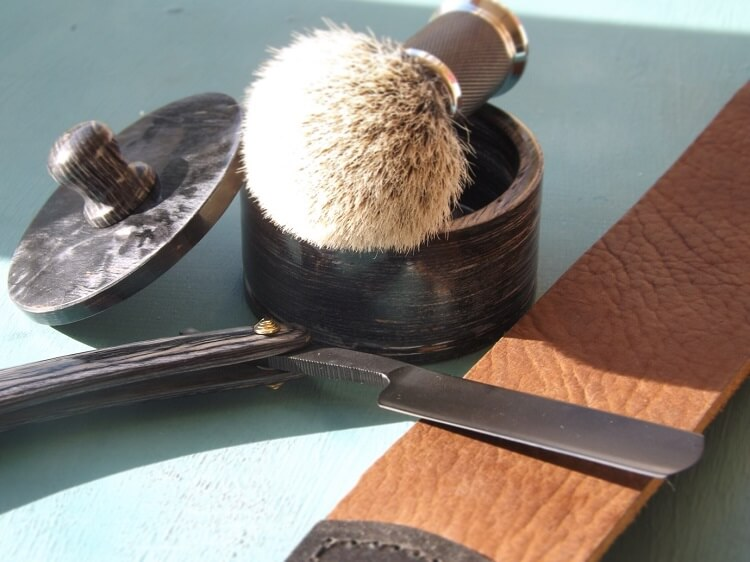 Safety razor blad strop and badger hair shaving brush with shaving bowl