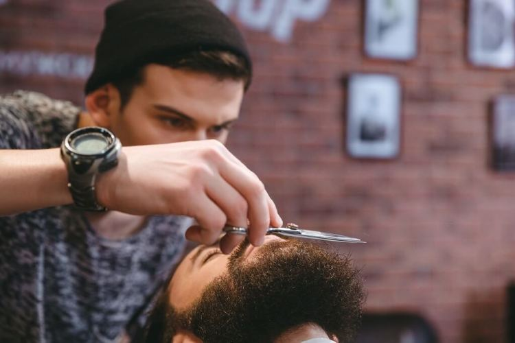 Curing beard split ends by properly trimming it with a scissors or beard trimmer before applying any product