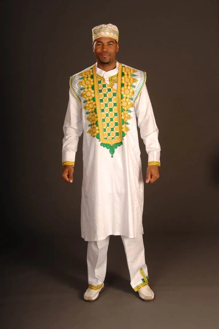 perfect stylish kaftan for weddings. White kaftan material with gold an green embroidery
