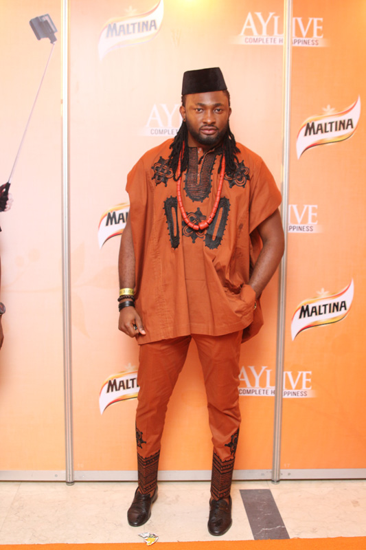 stylish man wearing traditional native wear on the red carpet