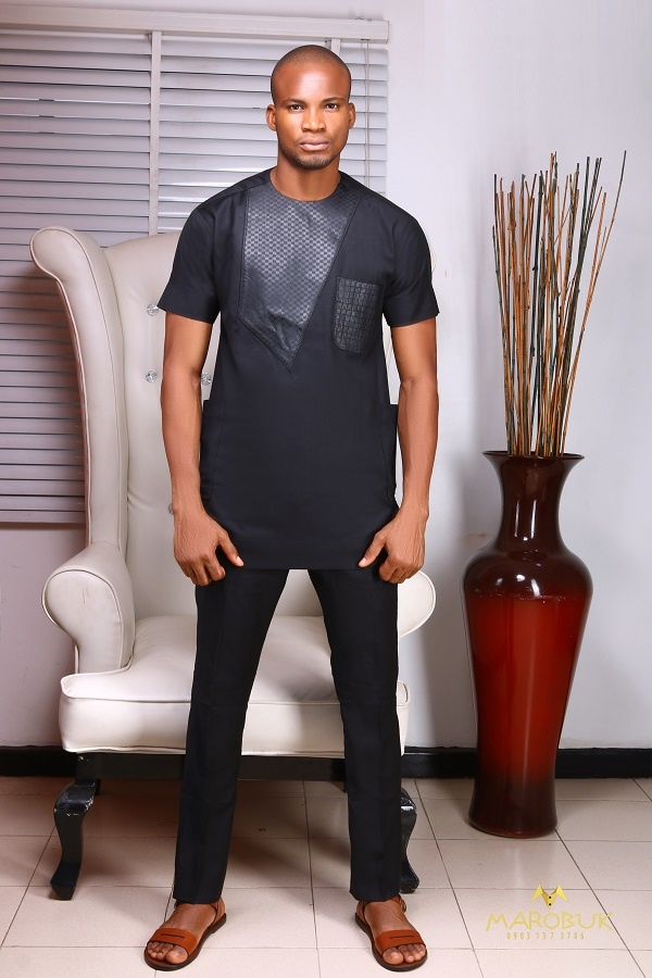 A Model Wearing A Short Sleeve Nigerian Men Traditional Wears Clothes designed by Chidiebere Ekwunife AKA Marobuk
