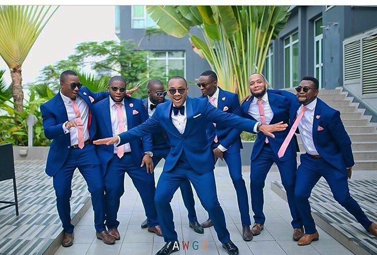 grooms men navy blue suit and peach necktie