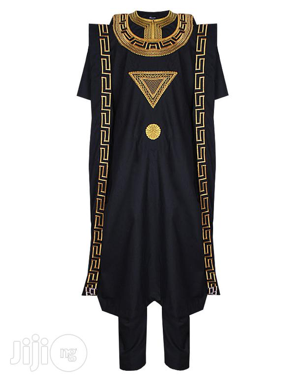 black and gold versace design agbada