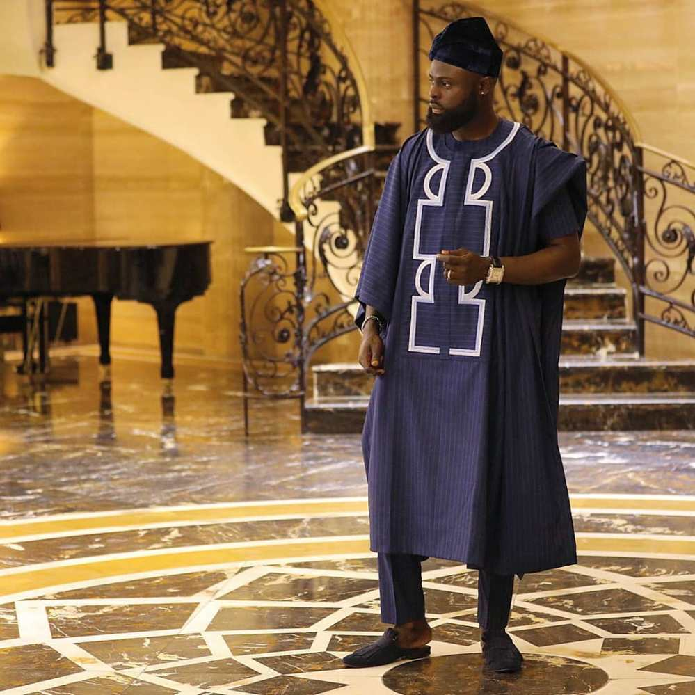 yomi casual in navy blue agbada and creative white embroidery