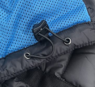 This KÜHL Firestorm Down Jacket review photo shows the drawcord at the hem.