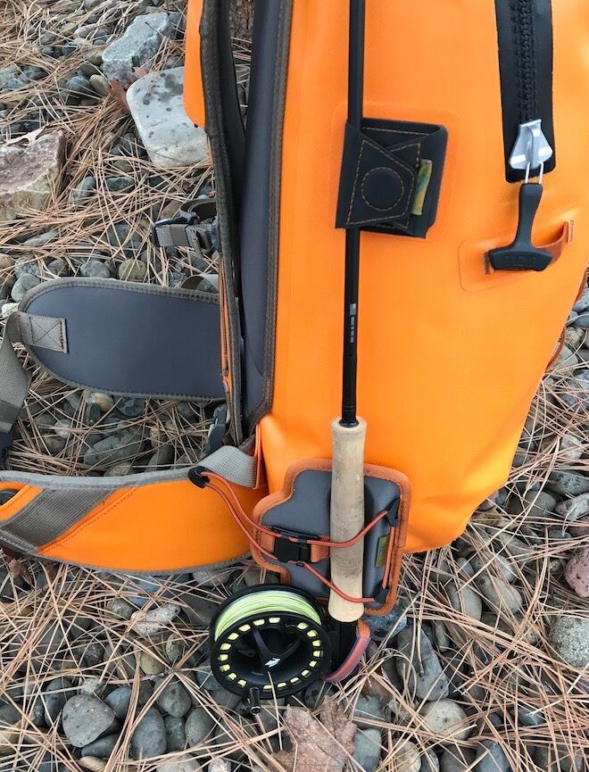 This photo shows the Fishpond Quickshot Rod Holder attacked to a Fishpond backpack with a fly fishing rod.