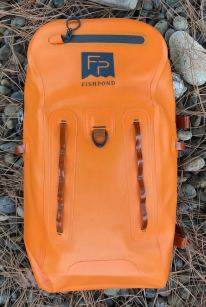 This review photo shows the front of the Fishpond Thunderhead Submersible Backpack.