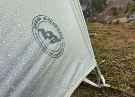 This photo shows the Big Agnes Fly Creek HV2 Platinum tent rain fly with raindrops on it.