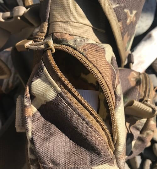 This photo shows the Alaska Guide Creations Classic MAX Pack Bino Harness side pocket.