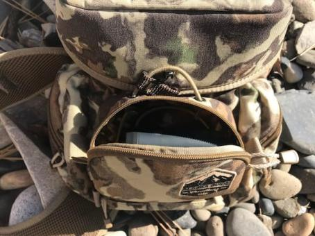 This photo shows the Alaska Guide Creations Classic MAX Pack Bino Harness rangefinder pocket.
