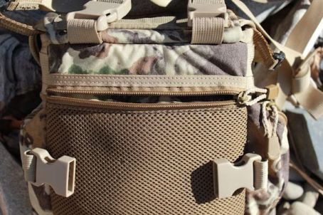 This photo shows the Alaska Guide Creations Classic MAX Pack Bino Harness rear pocket.