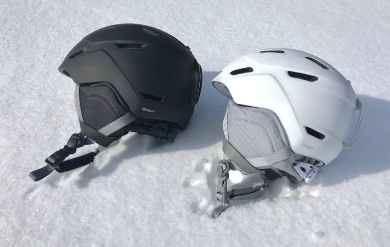 This photo shows the Smith Mission and Smith Mirage Snow Helmets outside on snow.