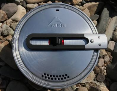 This photo shows the MSR WindBurner Stove System Combo shows the top of the 2.5-liter pot with handle and lid.