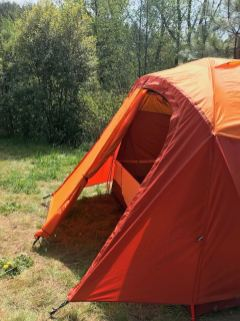 This photo shows the REI Co-op Kingdom 8 Tent front rainfly vestibule.