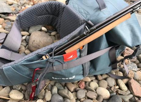 This photo shows the Umpqua Tongass 650 Waterproof Waist Pack with a backup rod tucked into the reel pocket.