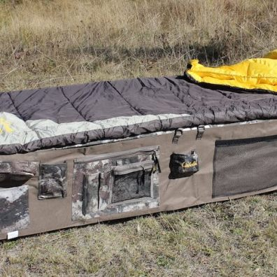 This photo shows the Cabela's O2 Octane Camp Cot with a sleeping bag on top.