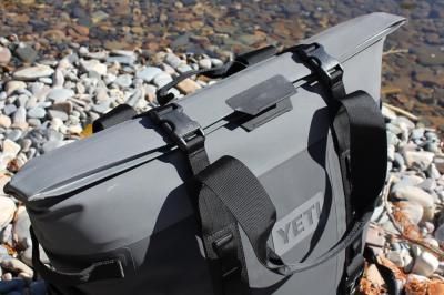 This photos shows the top of the YETI Hopper M30 'HydroShield' magnetic closure buckled down.
