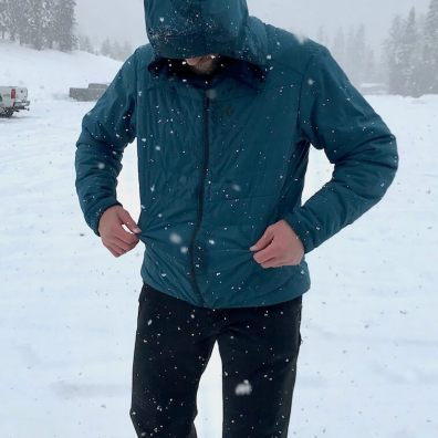 This photo shows the reviewer wearing the Black Diamond First Light Stretch Hoody.
