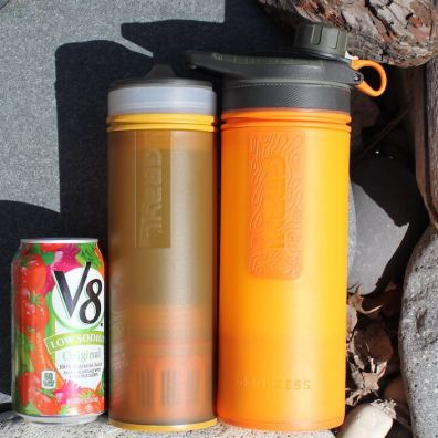 This photo shows the GRAYL ULTRALIGHT Purifier next to the GRAYL GEOPRESS Purifier and a standard 12 oz can.