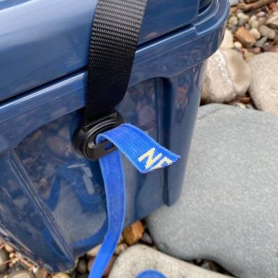 This YETI Roadie 24 review photo shows the strap system on the side of the YETI Roadie 24 hard cooler.