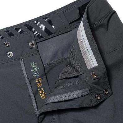 """This photo shows the zipper, fly and interior of the Showers Pass men's Gravel 10"""" Shorts."""