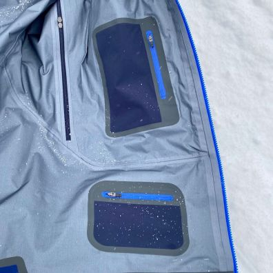This photo shows the interior media and pass pockets in the Stio men's Objective Pro skiing jacket.