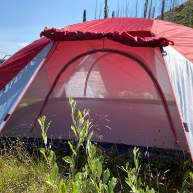 This photo shows the roll-up rainfly over the door on the L.L.Bean Mountain Light HV 3 Tent.