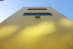 Yellow wall with blue windows