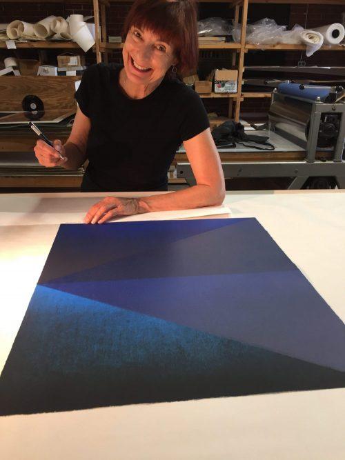Kate Petley signing prints at Manneken Press