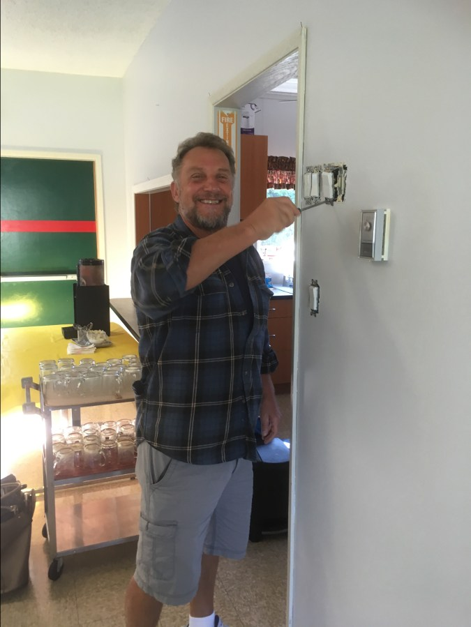 Franco Canil replaces electrical switches when painting clubhouse Sept 2020