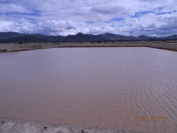 Jusku Molle reservoir filled with water.