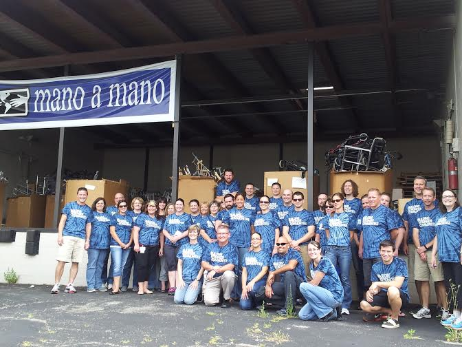 Volunteers from Boston Scientific working at the Mano a Mano warehouse in St. Paul, MN in August 2014.