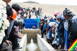 Farmers look on excitedly as water begins flowing.